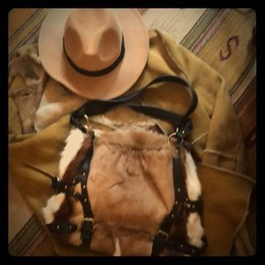 Multi-toned cow hide bag stands out w Blk trim